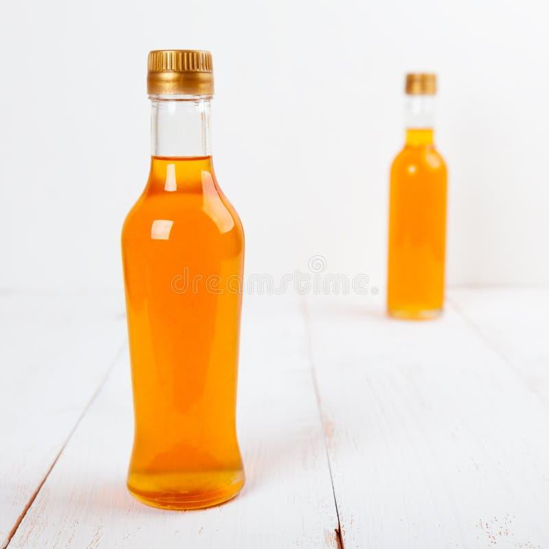 Due bottiglie di sciroppo immagini stock