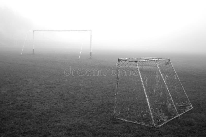 Due cancelli di calcio in foschia fotografia stock libera da diritti