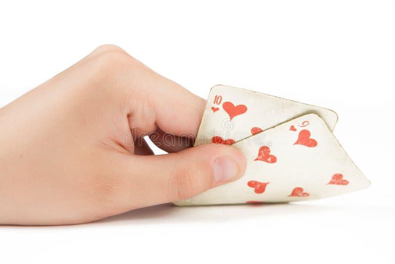 Due carte da gioco a disposizione isolate su fondo bianco fotografia stock libera da diritti