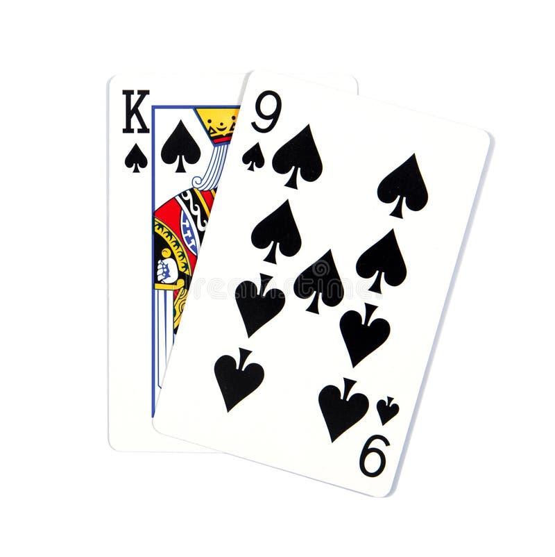 Due carte isolate su bianco K e 9 la regina delle vanghe isolate su fondo bianco immagine stock libera da diritti