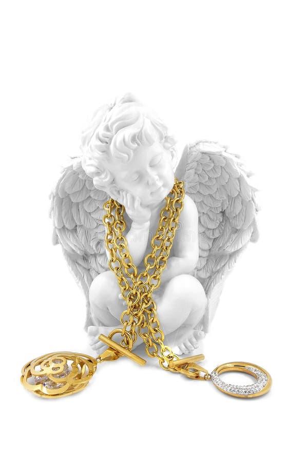 Due collane, oro ed argenti delle signore con i cristalli con un angelo fotografie stock libere da diritti