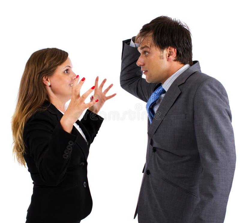 Due colleghi di affari che hanno un argomento fotografia stock libera da diritti