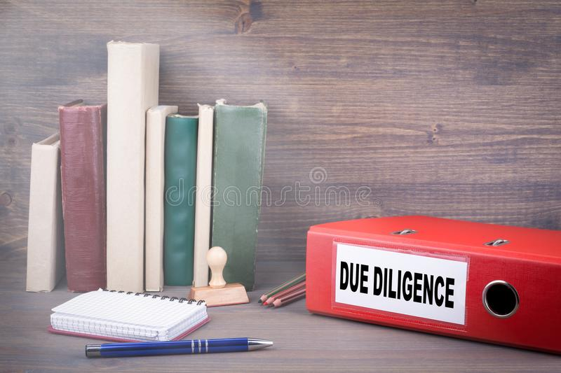 Due Diligence, Business Concept. Binder on desk in the office stock photography