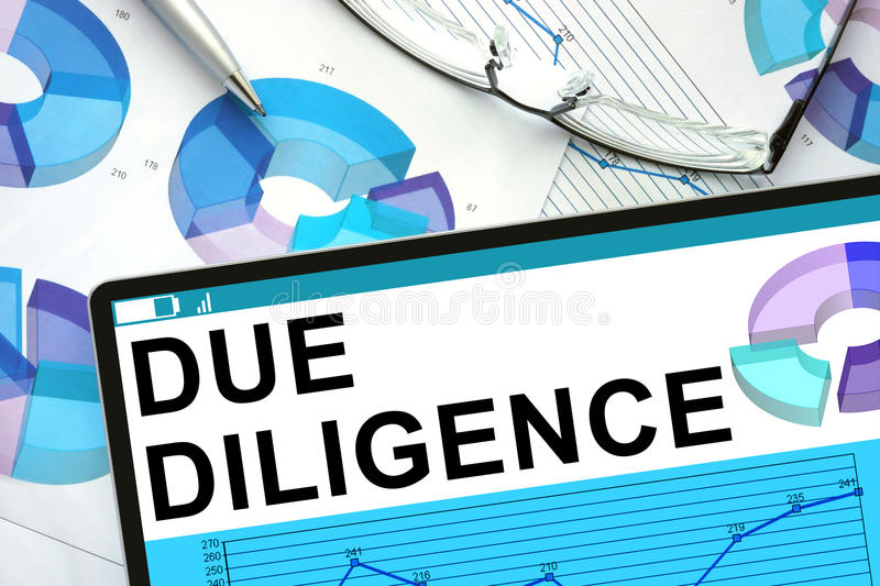 Due Diligence n tablet with graphs. Business concept royalty free stock photo