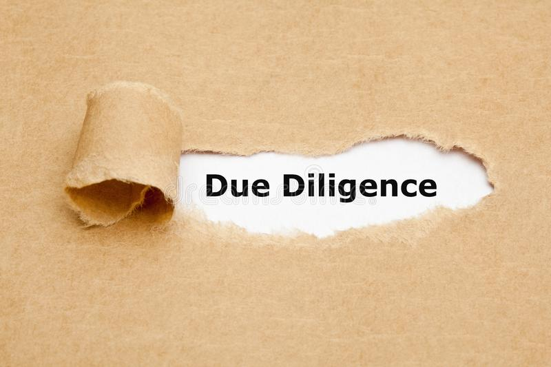 Due Diligence Risk Management Ripped Paper Concept. Text Due Diligence appearing behind torn paper. Concept representing the research done before entering into stock image