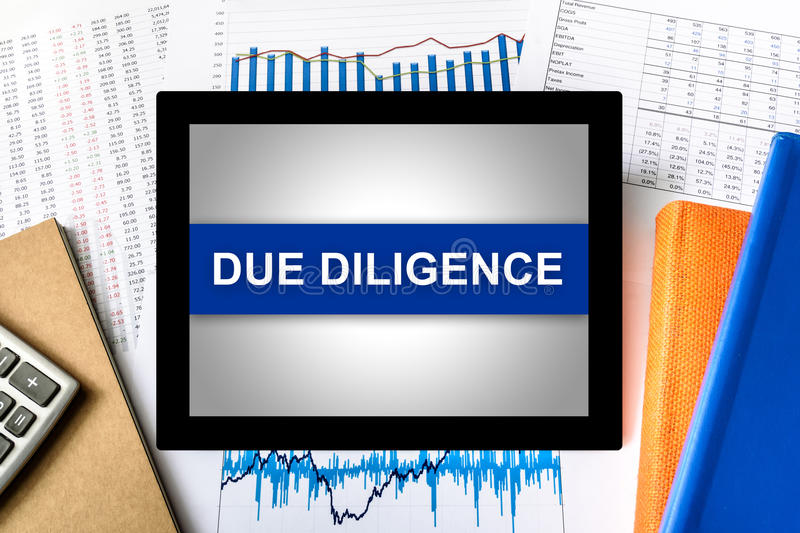 Due diligence word on tablet. With financial graph background royalty free stock photos
