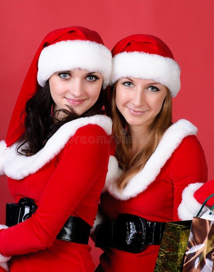 Due donne in vestito in come Santa fotografia stock