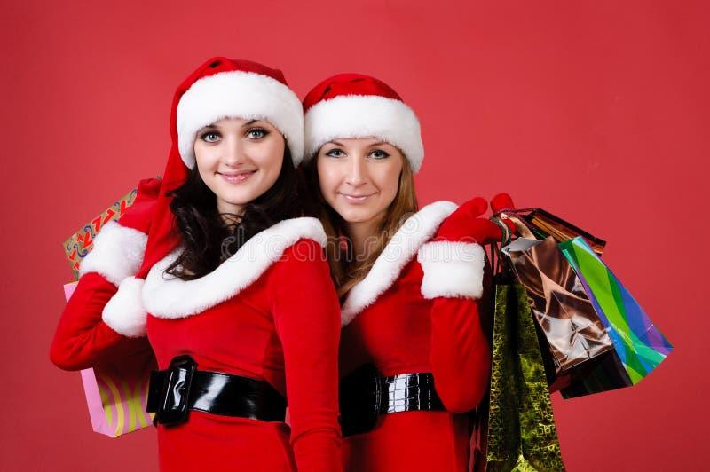 Due donne in vestito in come Santa immagini stock libere da diritti