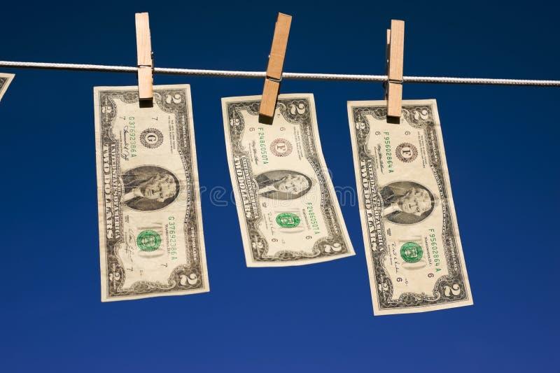 Due fatture del dollaro sul Clothesline fotografia stock libera da diritti