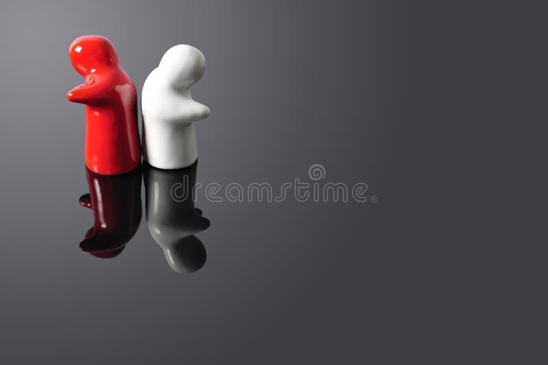 Due Figure Che Girano Loro Appoggia A Vicenda Immagine Stock
