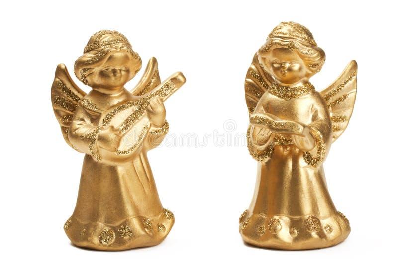 Due figurines dorati di angelo di natale fotografia stock