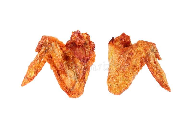 due friggono nel grasso bollente le ali di pollo isolate su bianco fotografia stock