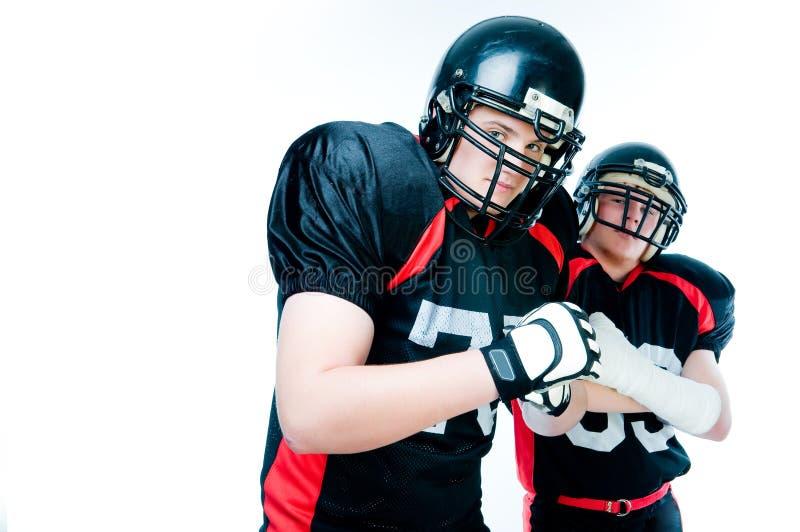 Due giocatori di football americano immagine stock
