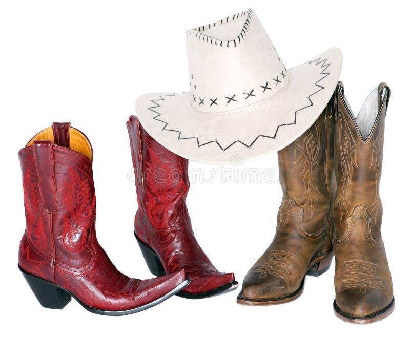 Due insiemi degli stivali con il cappello da cowboy immagini stock