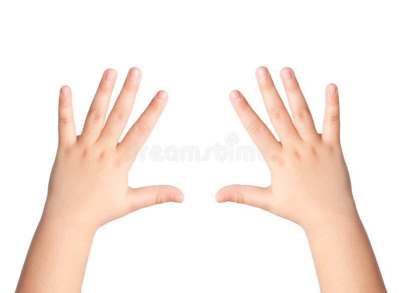 Due mani dei bambini su un fondo isolato fotografia stock