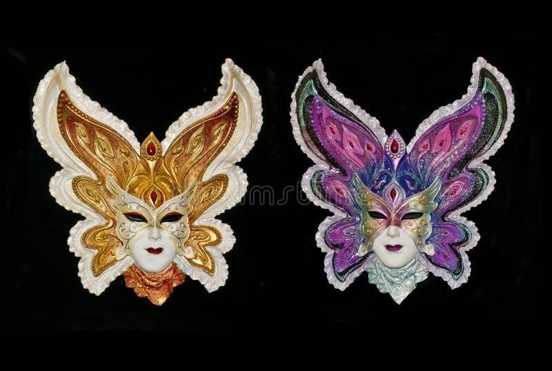 Due maschere veneziane di carnevale isolate fotografie stock libere da diritti