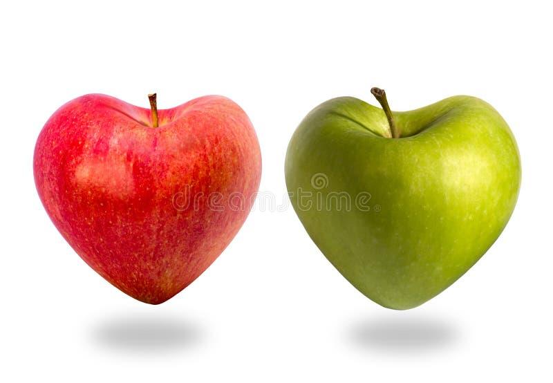 Due mele nelle forme di cuore fotografie stock libere da diritti