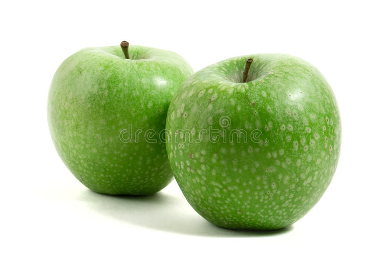 Due mele verdi fresche fotografia stock