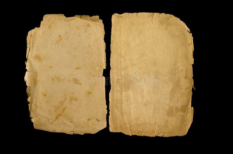 Due pagine gialle di vecchio libro su un fondo nero fotografia stock