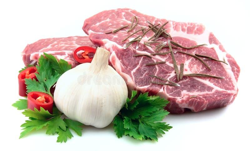 Due parti di carne con le spezie fotografie stock libere da diritti