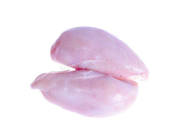 Due petti di pollo freschi crudi isolati su bianco immagine stock