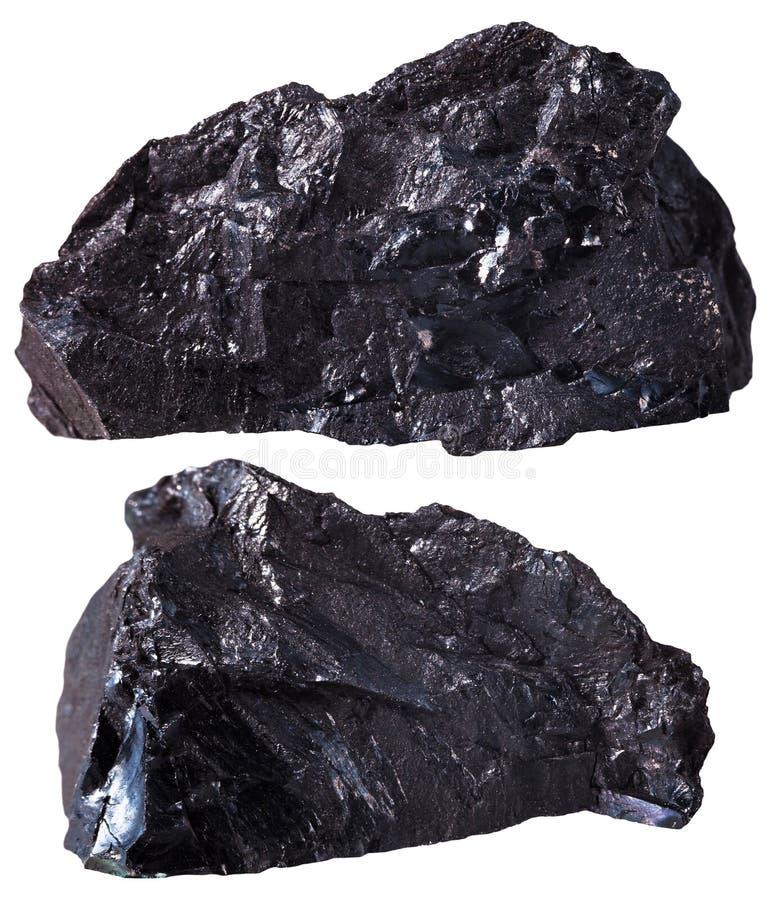 Due pezzi di minerale antracite nero (del carbone) immagini stock