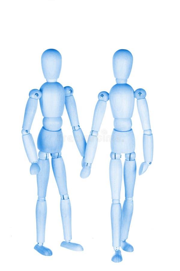 Due piccoli uomini di legno blu immagini stock