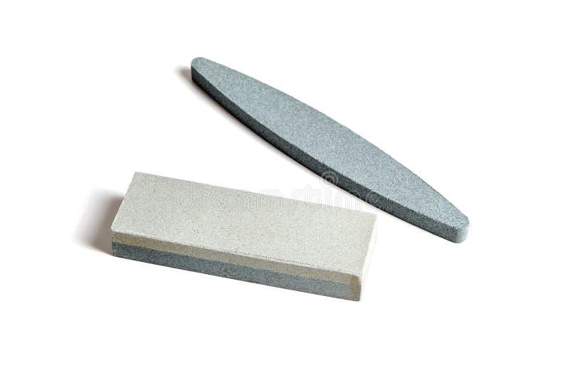 Due pietre d'affilatura isolate su fondo bianco immagine stock libera da diritti