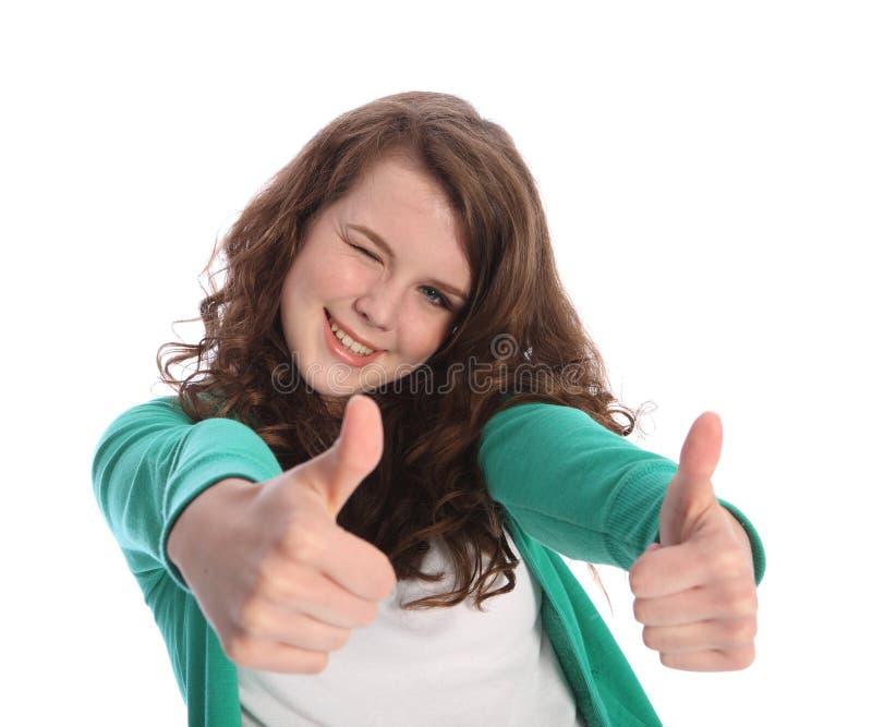Due pollici in su per successo dalla ragazza sorridente dell'adolescente immagine stock libera da diritti