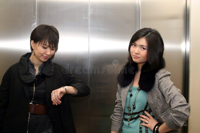 Due ragazze asiatiche fotografia stock