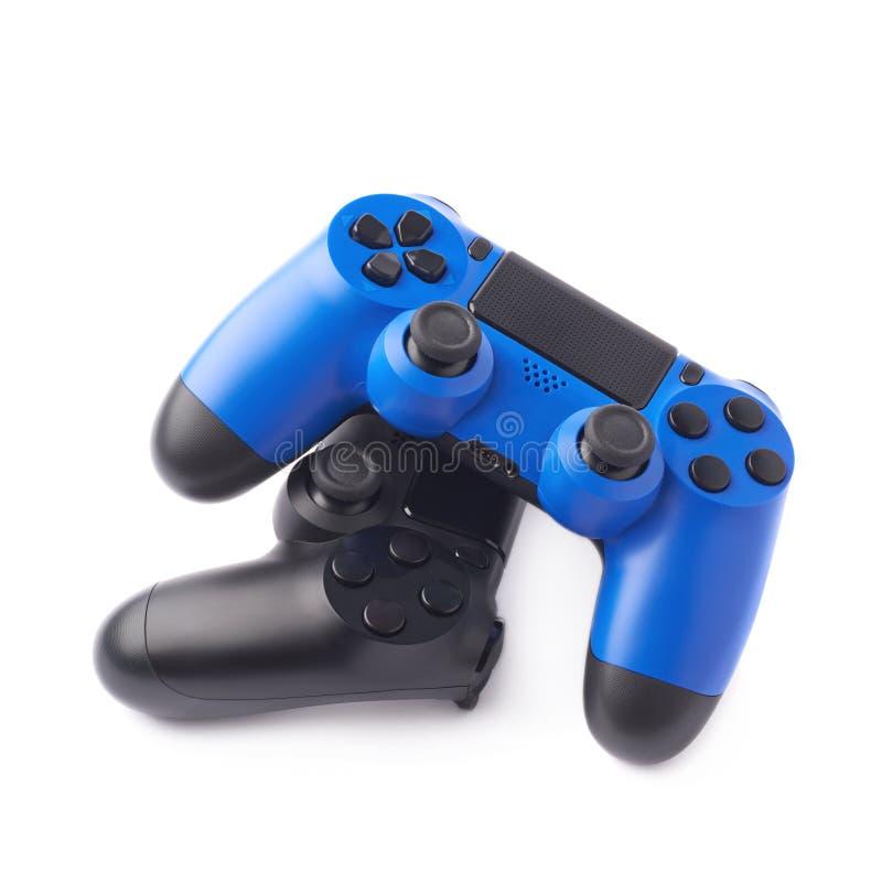 Due regolatori di console di gioco isolati immagini stock