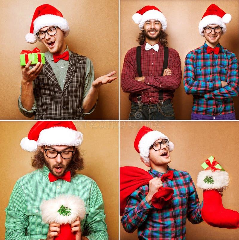 Due Santa Claus emozionale si sono vestiti nei pantaloni a vita bassa dei vestiti che stanno il Ne fotografia stock