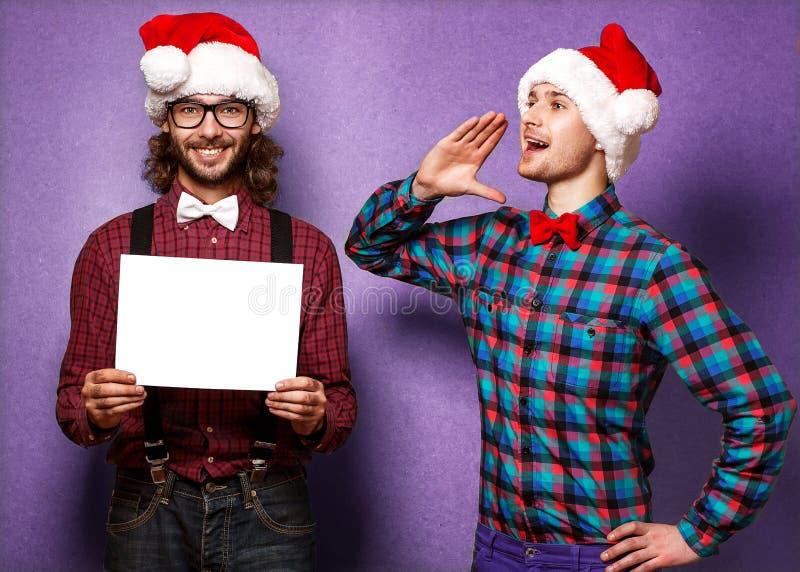 Due Santa Claus sorridente nel Natale fotografia stock libera da diritti