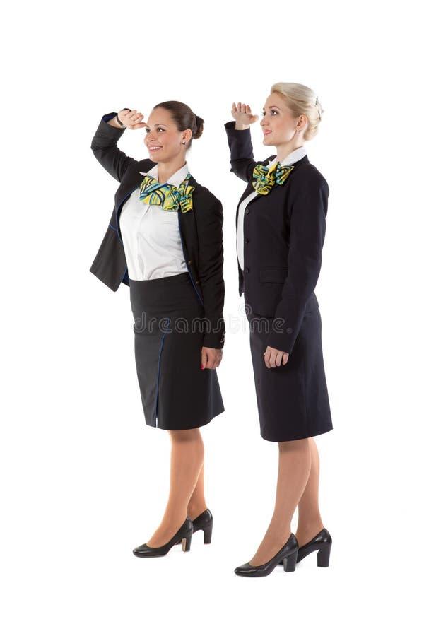 Due sorveglianti di volo accolgono il comandante della squadra fotografia stock libera da diritti