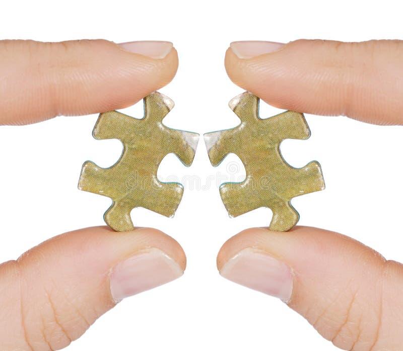 Due stesse parti del puzzle che non si adattano immagine stock