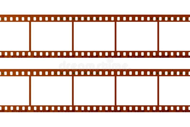 Due strisce del film di 35mm isolato su fondo bianco, fine su fotografia stock