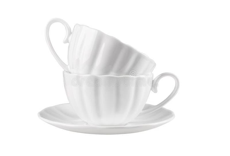 Due tazze ceramiche su un piattino fotografie stock libere da diritti