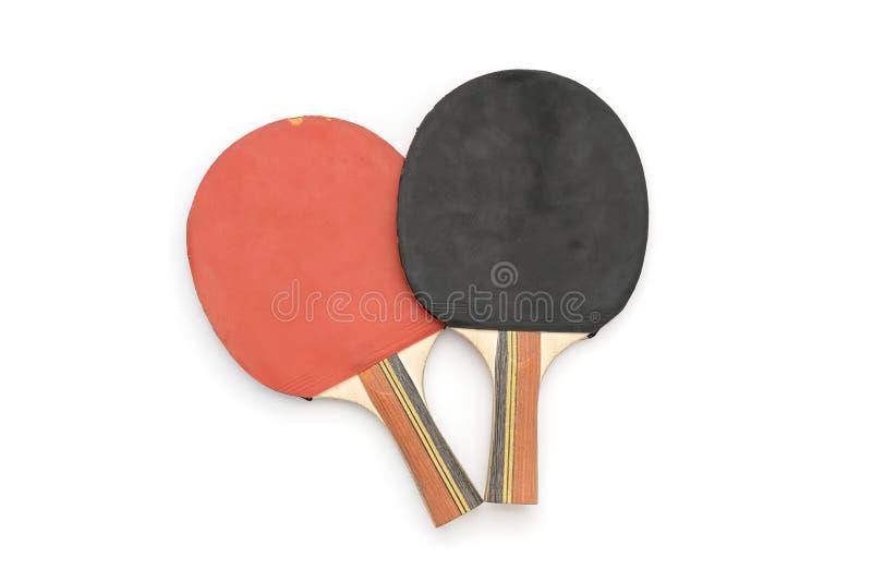 Due vecchie racchette rosse e nere di ping-pong immagini stock libere da diritti