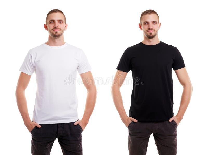 Due volte uomo in maglietta bianca e nera in bianco dalla facciata frontale su fondo bianco fotografia stock