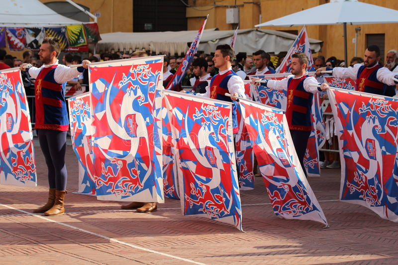Duel golden. Competition between flag wavers. Ferrara, Italy - 13 september 2015 - Duel gold, Duel golden. It 'a national competition among the flag bearers of royalty free stock photo