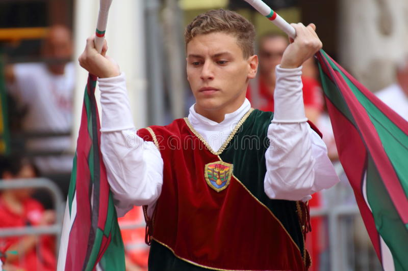 Duel golden. Competition between flag wavers. Ferrara, Italy - 13 september 2015 - Duel gold, Duel golden. It 'a national competition among the flag bearers of royalty free stock photography