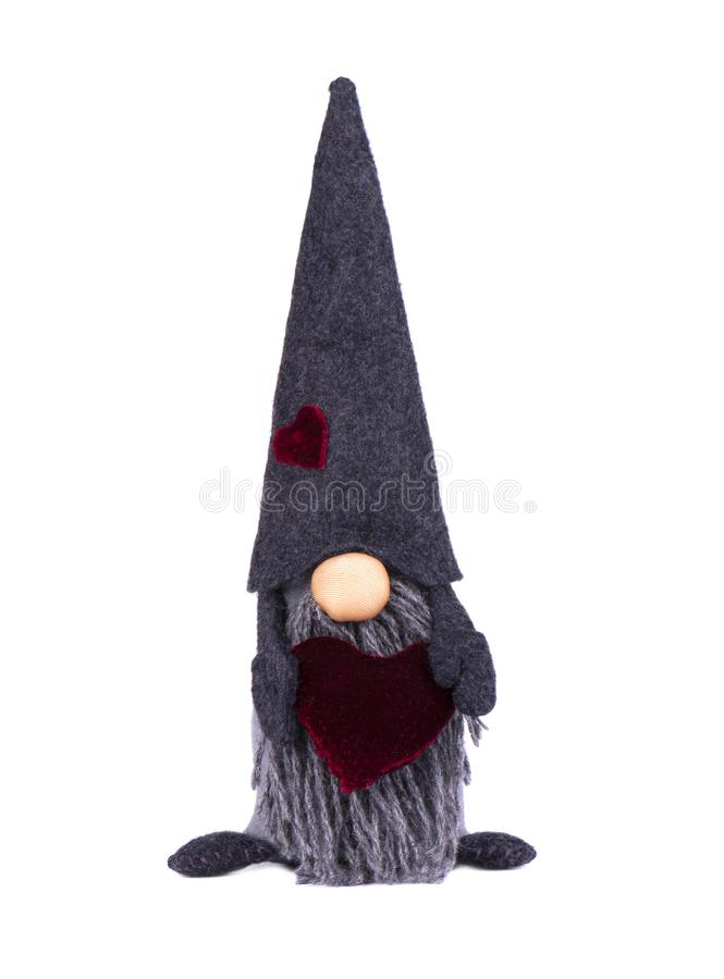 Duende de la Navidad con el sombrero acentuado Gnomo escandinavo, duende, juguete decorativo de la Navidad, aislado en el fondo b foto de archivo libre de regalías