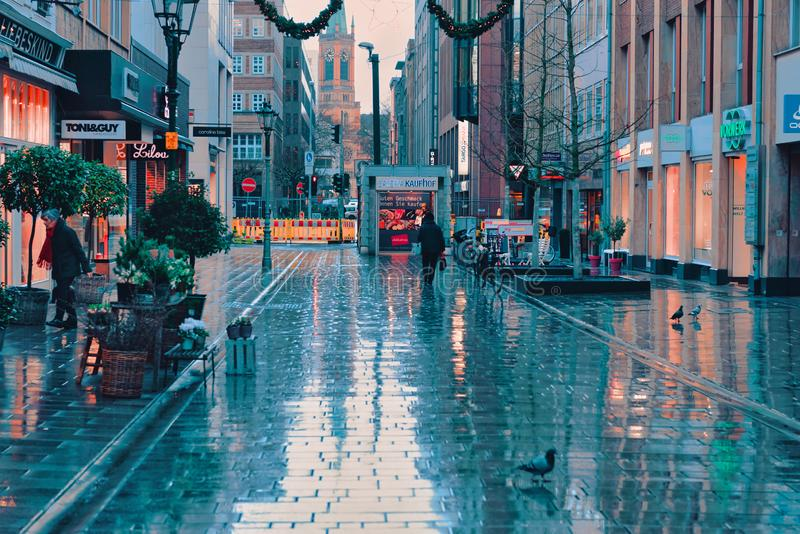 DUESSELDORF, GERMANY - JANUARY 05, 2017: View into a street near the Altstadt after rain started - high resolution -. Hyperrealistic royalty free stock images