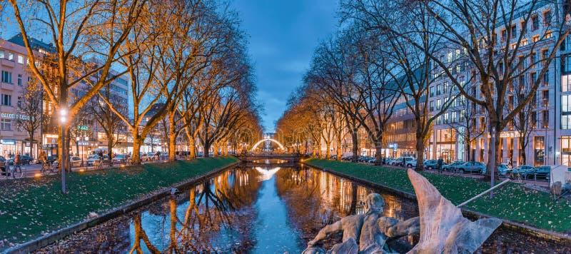 DUESSELDORF, GERMANY - NOVEMBER 28, 2017: Scenic Blue Hour Panorama of famous Koenigsallee. DUESSELDORF, GERMANY - NOVEMBER 28, 2017: Scenic Blue Hour Panorama stock image