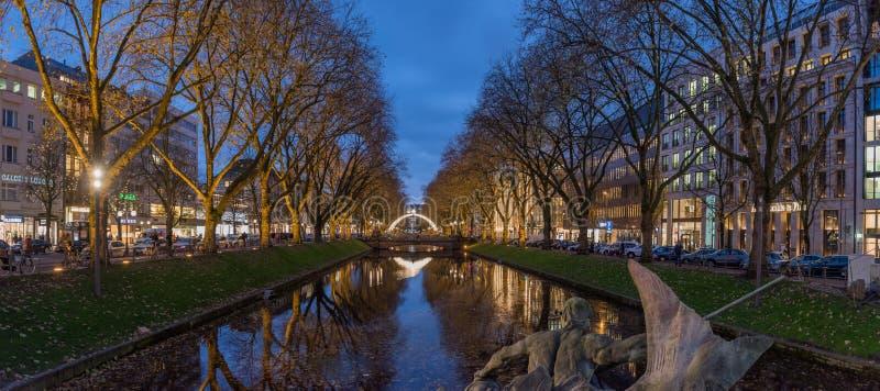 DUESSELDORF, GERMANY - NOVEMBERT 28, 2017: Scenic Blue Hour Panorama of famous Koenigsallee. DUESSELDORF, GERMANY - NOVEMBERT 28, 2017: Scenic Blue Hour stock photo