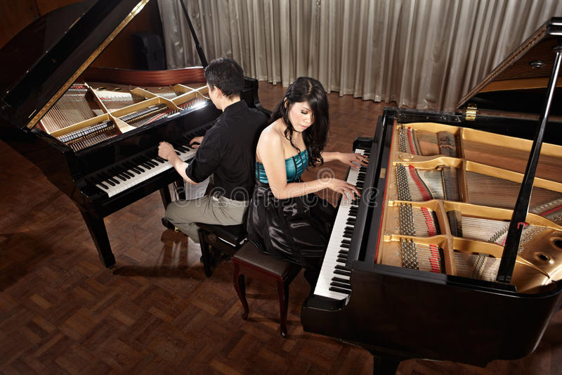 Duet with pianos stock photo