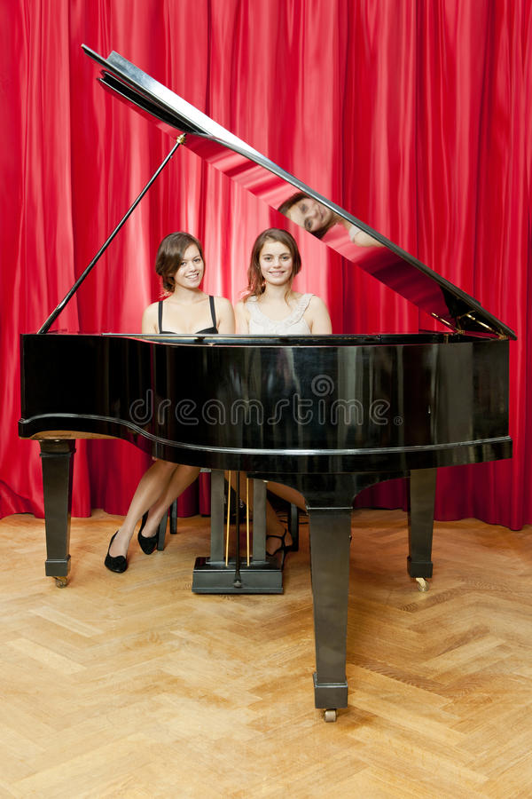 Duet on a single piano stock photo