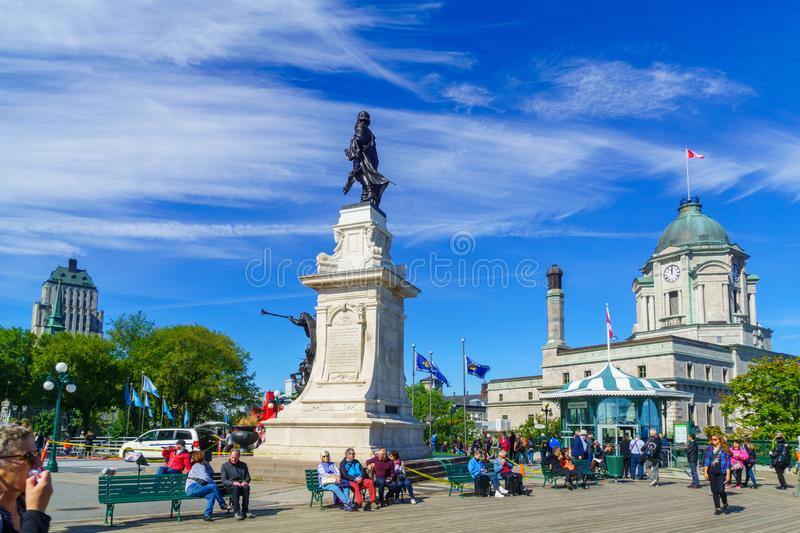 Dufferin Terrace and Armes square Place dArmes in Quebec City. Quebec City, Canada - September 27, 2018: Scene of the Dufferin Terrace and the Armes square Place royalty free stock image