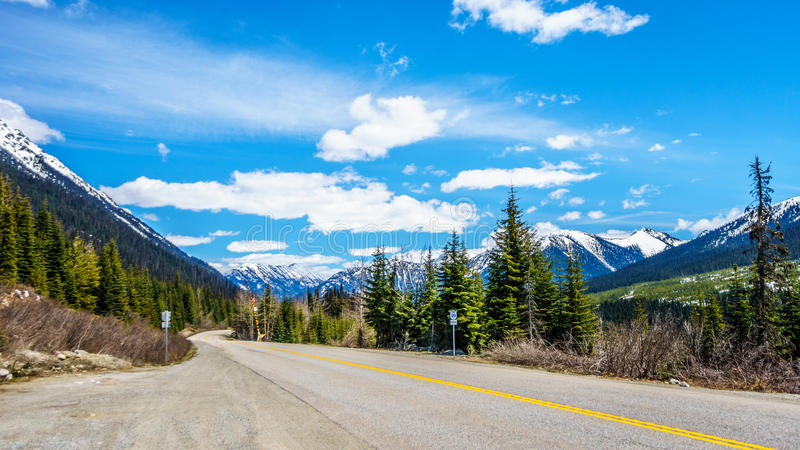 The Duffey Lake Road, Highway 99, as it winds through the snow covered Coast Mountain Range. Between Pemberton and Lillooet in southern British Columbia stock photos