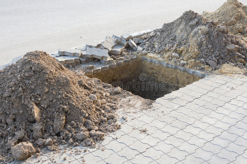 Dug a pit for planting trees on pavement of paving slabs. Dug a pit for planting trees on the pavement of paving slabs royalty free stock photography